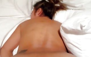 Gorgeous ebony beaver babe kneels and puts vibrator to pussy