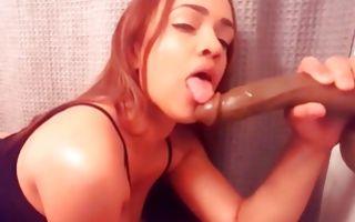 Tremendous amateur bitch posing and sucking huge dildo