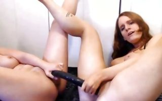 Two naughty amateur bitches nicely playing with big dildo