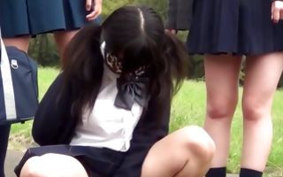 Three Asian bitches with hot bodies pissing outdoors